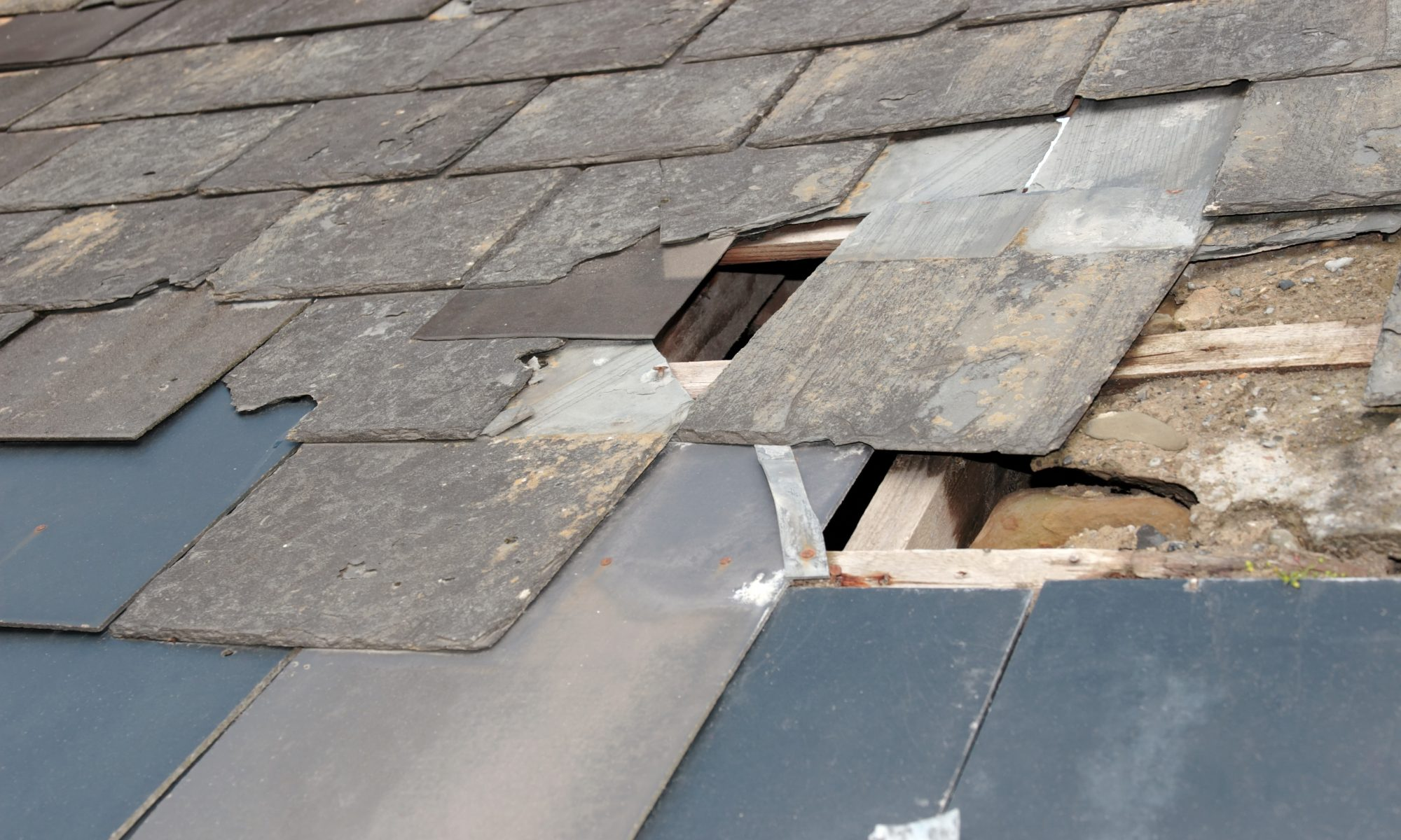Roof damage due to storm or decay