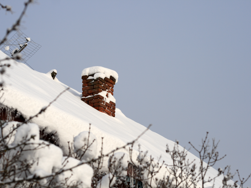 snow on residential roof